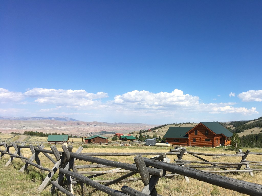 View of a fence and distant mountains in Wyoming